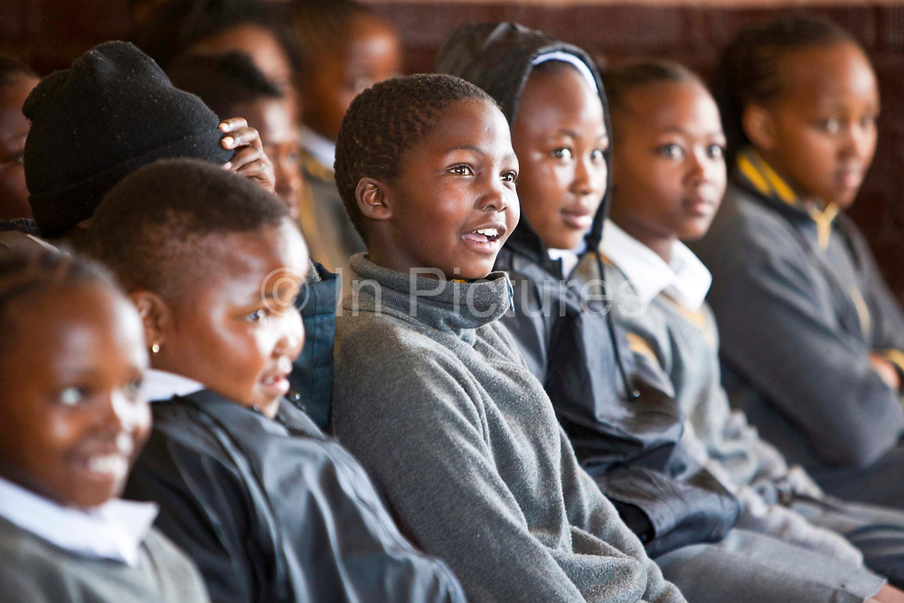 Children from Matsie Steyn primary school, Sharpeville, Vereeniging, South Africa, watch a performance of the show 'About Us – Stepping Up' an AREPP: Theatre for Life production providing interactive social life skills education to school children through theatre productions. They are based in Johannesburg, South Africa and are on tour for 3 months doing performances everyday at schools across the country.