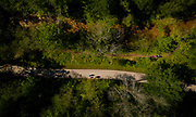 GREEN BAY, WISCONSIN - MAY 29, 2020: An aerial image of residents walking along the Baird Creek Greenway in Green Bay, Wisconsin on Friday, May 29, 2020. Trail renovation along the greenway is one of many public works projects that the City of Green Bay has proposed to utilize a piece the roughly $2 trillion federal stimulus package at a local level.CREDIT: Ben Brewer for the New York Times