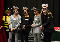 Catherine Pingol, Maria McGrath, Emma O'Neill and Olivia DeMatos Holy Trinity School's Three Blind Mice team brought along a fourth mouse to the Lakes Region Scholarship Foundation 16th annual Community Spelling Bee at Laconia High School on Thursday evening.  (Karen Bobotas/for the Laconia Daily Sun)