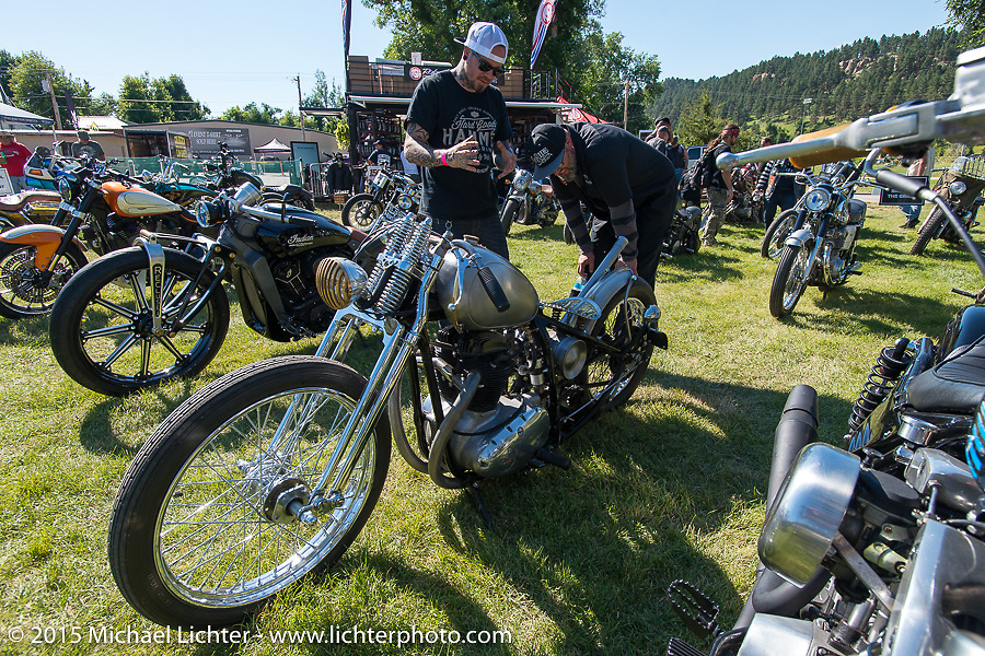 "Ola Stenegard (in dark cap,) the head of design at BMW Motorcycles at the ""Built for the Ride"" bike show presented by RSD in City Park during the 75th Annual Sturgis Black Hills Motorcycle Rally.  SD, USA.  August 1, 2015.  Photography ©2015 Michael Lichter."