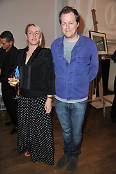 LAURA LOPES and TOM PARKER-BOWLES at a party to celebrate the 60th birthday of Mark Shand and the 50th birthday of Tara the elephant held at 29 Portland Place, London on 25th May 2011.
