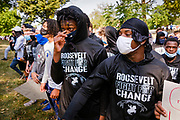 07 SEPTEMBER 2020 - DES MOINES, IOWA: High school athletes picket the Iowa Governor's Mansion. About 300 Des Moines Public School (DMPS) high school athletes marched through Des Moines to the Governor's Mansion Monday to protest Gov. Kim Reynolds' recent efforts to reopen schools. DMPS, the largest school district in Iowa, is suing to go to online instruction because of the COVID-19 pandemic. The Governor is trying to force the district to reopen with in person instruction. The state ruled that schools using online education can't participate in extracurricular activities, including sports. The student athletes, who all wore face masks to comply with CDC guidelines, were marching to demand the ability to participate in sports despite using online instruction.      PHOTO BY JACK KURTZ