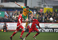Photo: Rich Eaton.<br /> <br /> Tamworth FC v Norwich City. The FA Cup. 06/01/2007. Jason Shackell centre of Norwich climbs high above Tamworths Kyle Storer left and Darryl Taylor right