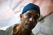 Man selling food at night in Gibara at the Festival del Cinema Pobre, Holguin Province, Cuba.