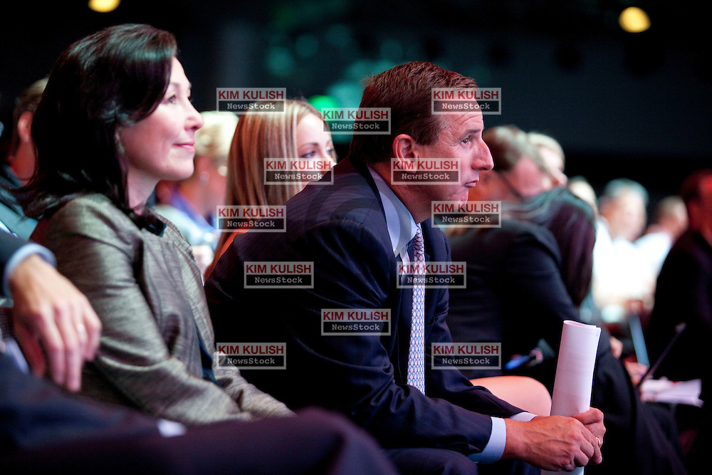 Safra Catz, left, and Mark Hurd, right, both co-presidents of Oracle Corp., listen to Larry Ellison, chief executive officer of Oracle Corp., speak at the annual Oracle OpenWorld conference in San Francisco, California.   Oracle is launching new software an hardware products at the annual event.