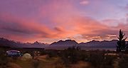 """The last rays of sunset brighten clouds with pink and magenta color over Aoraki / Mount Cook, (3755 meters or 12,349 feet) in Aoraki / Mount Cook National Park, South Island, New Zealand. In 1990, UNESCO honored Te Wahipounamu - South West New Zealand as a World Heritage Area. In 1990, UNESCO honored Te Wahipounamu - South West New Zealand as a World Heritage Area. Published in """"Light Travel: Photography on the Go"""" by Tom Dempsey 2009, 2010. Panorama stitched from 2 overlapping photos."""