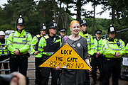 Dame Vivienne Westwood is againts the fracking in Balcombe and has come to the protest site for the afternoon to show her support. Here she is outside the gates to the site where Cuadrilla wants to run fracking tests.