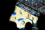 21 MAR 2015: Andrew Harrison (5) of University of Kentucky takes a three point shot over Shaq Thomas (3) of the University of Cincinnati during the 2015 NCAA Men's Basketball Tournament held at the KFC Yum! Center in Louisville, KY. Kentucky defeated Cincinnati 64-51. Brett Wilhelm/NCAA Photos