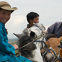 Young nomadic herders at a naadam festival on a remote pass in Arbulag Sum, near Muren in Hovsgol Aimag, Mongolia.