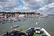 Car ferry leaving the port of Cowes on the Isle of Wight. This is one of the mos popular yacht sailing places in the UK.