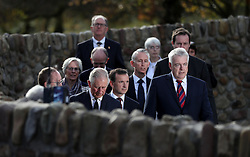 The Prince of Wales and First Minister of Wales Carwyn Jones (right) leave the Aberfan Memorial Garden in Wales, on the 50th anniversary of the Aberfan disaster.