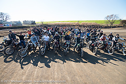 Vintage racers assemble for a group photo during Brat Style's flat track racing at West Point Offroad Village. Kawagoe, Saitama. Japan. Wednesday December 6, 2017. Photography ©2017 Michael Lichter.