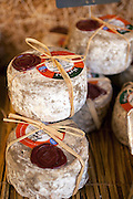 A stack of local artisan made cheeses in L' Isle-sur-la-Sorgue, France