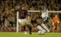 Photo: Leigh Quinnell.<br /> Arsenal v Fulham. The Barclays Premiership.<br /> 24/08/2005. Arsenals Mathieu Flamini battles with Fulhams Luis Boa Morte.