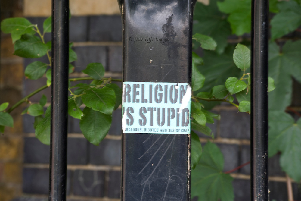 """Sign posted on a stanchion under a bridge over the Regents Canal, London: """"religion is stupid"""""""