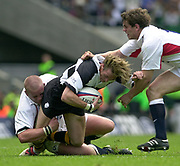 Twickenham. England. RFU Stadium, Surrey. <br /> Photo Peter Spurrier25/05/2003<br /> 2003 - Rugby - England v Barbarians.<br /> Percy Montgomery is caught by Phil Vickery, low, and Ben johnson moves in         [Mandatory Credit: Peter SPURRIER/Intersport Images]