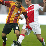 Galatasaray's Arda TURAN (L) and Ajax's Andre OOIJER (R) during their Friendly soccer match Galatasaray between Ajax at the Turk Telekom Arena at Arslantepe in Istanbul Turkey on Saturday 15 January 2011. Turkish soccer team Galatasaray new stadium Turk Telekom Arena opening ceremony. Photo by TURKPIX