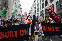 London, UK. 27th August, 2021. Marvina Newton leads environmental activists from Extinction Rebellion on a Blood Money March through the City of London on the fifth day of Impossible Rebellion protests. Extinction Rebellion were intending to highlight financial institutions funding fossil fuel projects, especially in the Global South, as well as law firms and institutions which facilitate them, whilst calling on the UK government to cease all new fossil fuel investment with immediate effect.