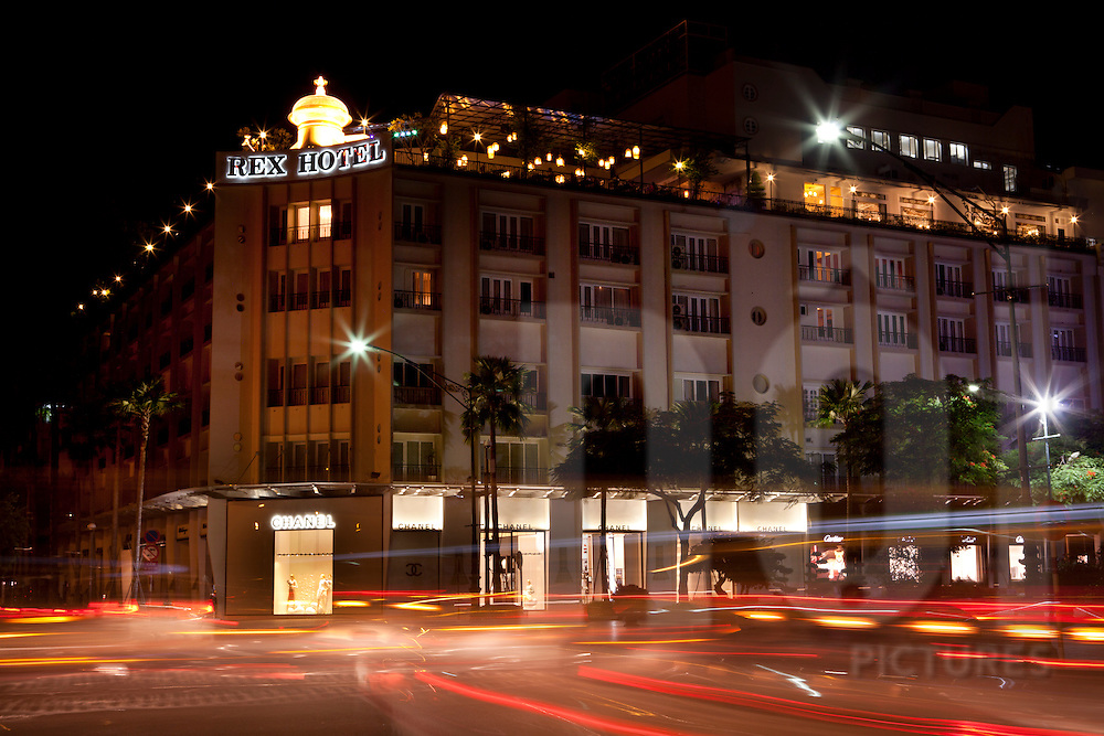 Rex Hotel with the Chanel Store at night in Ho Chi Minh city, Vietnam, Asia