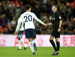 Tottenham Hotspur's Dele Alli shakes hands with referee Michael Oliver during the Premier League match at Wembley Stadium. London.