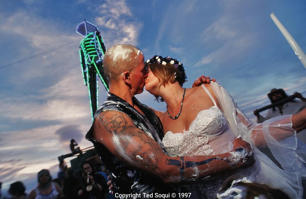 A wedding taking place under the Burningman..The Burningman festival on the playa near Black Rock in NE Nevada.