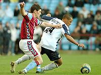 Photo: Ed Godden.<br />Aston Villa v Portsmouth. The Barclays Premiership. 04/03/2006. Gareth Barry (L) challenges Pompey's Wayne Routledge.