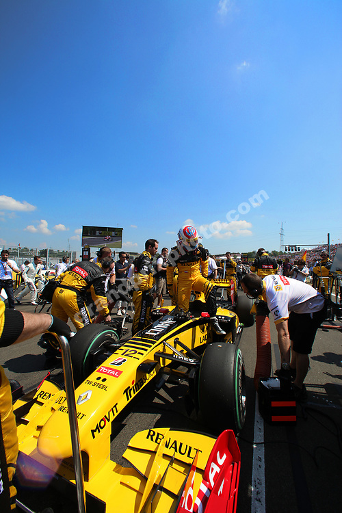 Vitaly Petrov gets out of his Renault on the grid before the 2010 Hungarian Grand Prix at the Hungaroring outside Budapest. Photo: Grand Prix Photo