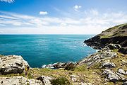 Views out across the calm blue sea and sky from the Nprth Coast cliff paths on a sunny day in Spring in Jersey CI
