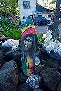 Bob Marley on surfboard, Keei Beach, Kealakekua, Island of Hawaii, Hawaii