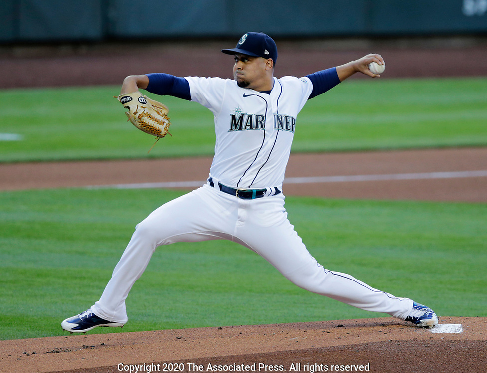 Seattle Mariners starting pitcher Justus Sheffield works against the Texas Rangers during the first inning of a baseball game, Saturday, Aug. 22, 2020, in Seattle. (AP Photo/John Froschauer)