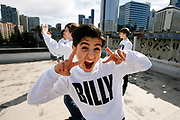 """SEATTLE, WASHINGTON--3/23/11--  Elton John's musical adaption of the movie """"Billy Elliot"""" comes to Portland from its last stop in Seattle, bringing with it four young performers who rotate in the demanding role of the star, Billy Elliot. Giuseppe Bausilio, 13, hams it up on the roof of the Paramount Theater in Seattle. Behind him, at the left, is Kylend Hetherington, 13 and, at the right,  Daniel Russell, 14. Not visible is the other Billy, Lex Ishimoto, 13.  Photo by Randy L. Rasmussen/The Oregonian"""
