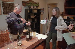 California: Napa City, Jessup Cellars man pours wine for patron of Napa B&B Holiday Tour at Inn on Randolph.Photo copyright Lee Foster.  Photo # canapa106866