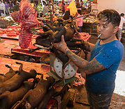 Weighing and selling dogs at Tomohon extreme market, Minahasa, northern Sulawesi, Indoensia.