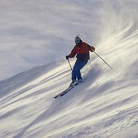Skiers on the Cornice runs at Mammoth Mountain.