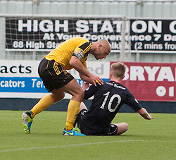 Livingston Simon Mensing argues with Falkirk's Craig Sibbald, after bringing him down for their penalty.<br /> Falkirk 1 v 1 Livingston, Scottish Championship game today at The Falkirk Stadium.<br /> © Michael Schofield.
