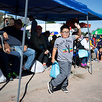 Ezra Yazzie, 6, from <br /> St. Michaels, Arizona waves as he watches the Navajo Nation Fair Parade pass in front of him  Saturday Sept. 8, 2018 near Window Rock, Arizona.