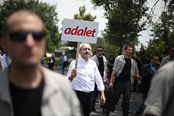 """June 15, 2017 - Ankara, Turkey - Main opposition Republican People's Party (CHP) leader Kemal KilicdaroÄŸlu (C) said """"enough is enough"""" as he began a march from Ankara to Istanbul in protest at the detention of CHP lawmaker Enis Berberoglu, on June 15, in Ankara,, Turkey. """"We do not want any journalists, any lawmakers to be in jail in our country,"""" Kilicdaroglu said at Ankara's central Güvenpark as he set out to walk to Istanbul in protest at the imprisonment of Berberoglu. Prior to Kilicdaroglu's arrival, thousands of people gathered in Guvenpark in support of the protest. """"This is a holy march. Justice, justice and justice. This march is not about a political party, it is about justice,"""" he said on arrival. (Credit Image: © Depo Photos via ZUMA Wire)"""