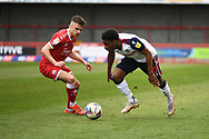 Crawley Town Midfielder Archie Davies (15)  and Bolton Wanderers Forward Oladapo Afolayan (30)  battles for possession during the EFL Sky Bet League 2 match between Crawley Town and Bolton Wanderers at The People's Pension Stadium, Crawley, England on 8 May 2021.