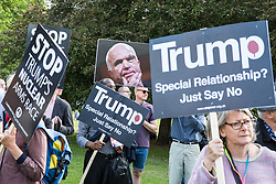 London, UK. 3 June, 2019. An image of former US senator John McCain held by protesters attending a noise demonstration outside Buckingham Palace against the state visit of President Trump to the UK. The US President is scheduled to attend a banquet at Buckingham Palace this evening.