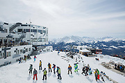 Skiers and snowboarders gather at the Crap Sogn Gion summit station on 6th April 2018 in Laax Ski Resort, Switzerland. At an altitude of 2,252 metres the The Crap Sogn Gion is a mountain restaurant, gondola station and meeting point at the Swiss ski resort of Laax in Graubunden, Switzerland.