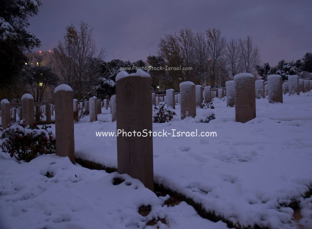 Israel, Jerusalem, Commonwealth World War I cemetery on Mt. Scopus, graves covered with snow Winter, January 2007