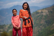 Manju and Saleena Lama, two children from local families where rebuilding work is taking place after the 2015 earthquake, Kakani, Nuwakot District, Nepal