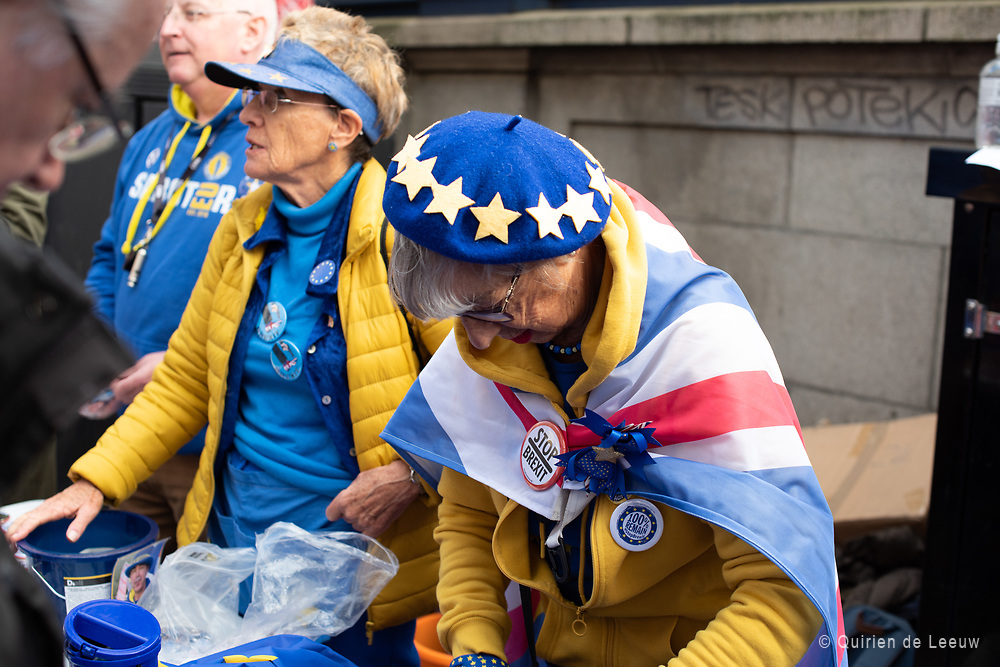Volunteers selling Pro-EU buttons and heads at the People's Vote March