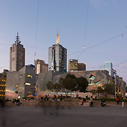 People gathering at Federation Square, Melbourne at night