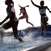Purity Kirui, (right), Kenya, and other competitors in action at the water jump in the Women's 3000m Steeplechase during the Diamond League Adidas Grand Prix at Icahn Stadium, Randall's Island, Manhattan, New York, USA. 14th June 2014. Photo Tim Clayton