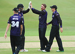 Tom Smith of Gloucestershire celebrates with team mates after getting out Sean Terry of Hampshire  - Photo mandatory by-line: Dougie Allward/JMP - Mobile: 07966 386802 - 14/07/2015 - SPORT - Cricket - Cheltenham - Cheltenham College - Natwest T20 Blast