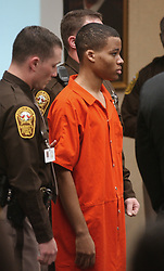 FILE PHOTO - A federal judge has tossed out two life sentences for D.C. sniper Lee Boyd Malvo and ordered new sentencing hearings due to a 2012 Supreme Court ruling that made it unconstitutional for juveniles to receive mandatory life sentences in prison without parole. PICTURED: Oct 20, 2003 - Virginia Beach, Virginia, U.S. - Sniper suspect LEE BOYD MALVO listens to court proceedings as he is surrounded by sheriff's officers during the trial of fellow sniper suspect John Allen Muhammad in courtroom 10 at the Virginia Beach Circuit Court in Virginia Beach. (Credit Image: © Martin Smith-Rodden/The Virginian-Pilot/ZUMA Press)
