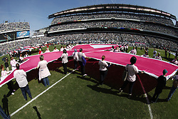 A large Breast Cancer Awareness ribbon is held by volunteers before the NFL game between the Detroit Lions and the Philadelphia Eagles on Sunday, October 14th 2012 in Philadelphia. The Lions won 26-23 in Overtime. (Photo by Brian Garfinkel)