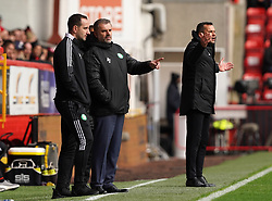 Celtic manager Ange Postecoglou (centre) speaks with assistant John Kennedy as Aberdeen manager Stephen Glass gestures during the cinch Premiership match at Pittodrie Stadium, Aberdeen. Picture date: Sunday October 3, 2021.