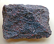 Eclogite ( is a colourful rock that is formed within the Earth under great temperatures, mafic (basaltic in composition) metamorphic rock near Cesky Krumlov, Jihocesky, region, Czech Republic.